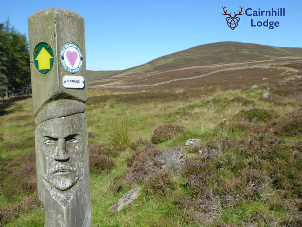 A wooden way-marker post for the Cateran Trail long distance footpath in Perthshire and Angus
