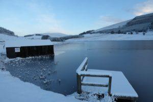 Boat house on Loch Shandra in winter snows