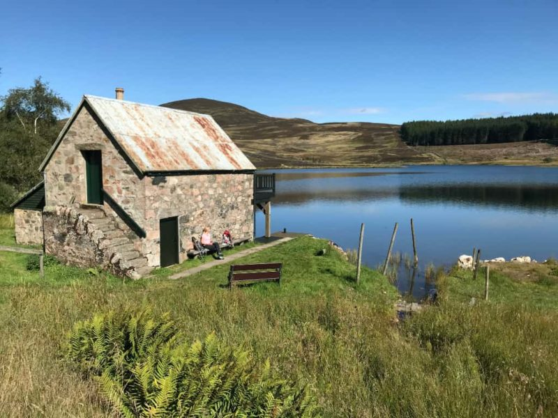 Soaking up the sun at the boat house on Auchintaple Loch