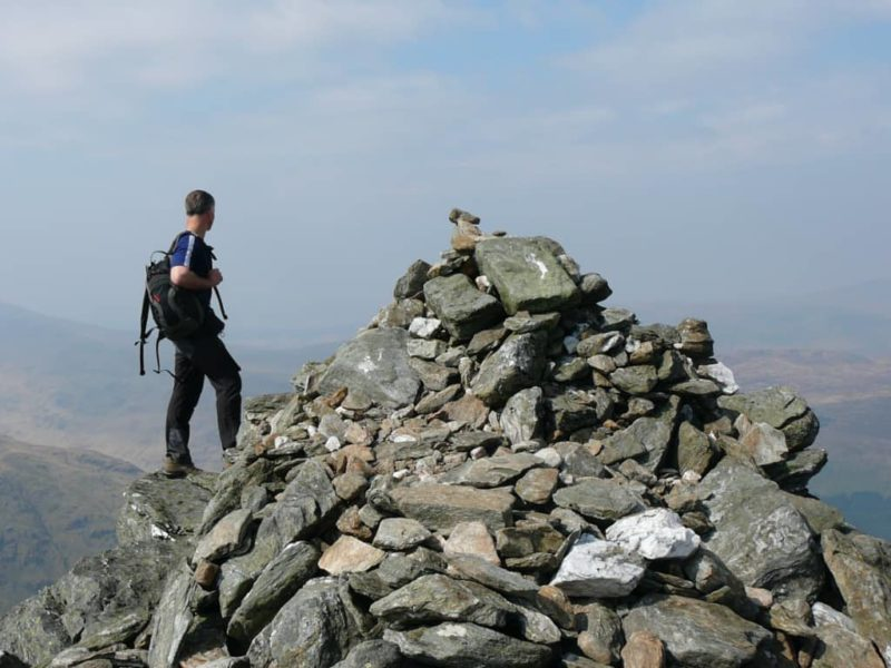 Admiring the view from a summit cairn above Glenisla