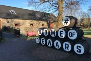 Whisky barrels stacked outside of Dewar's Aberfeldy distillery