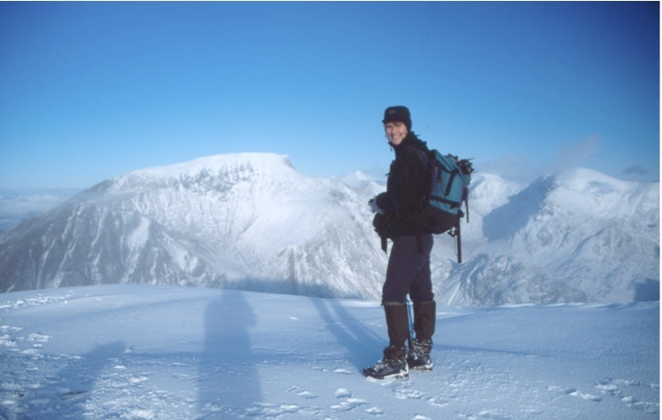 Elaine on the summit of Sgurr a Mhaim with the south face of Ben Nevis in the background