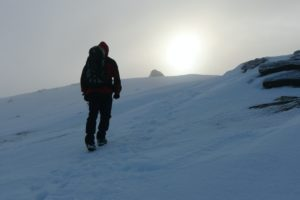 Nearing the summit in weak winter sunshine